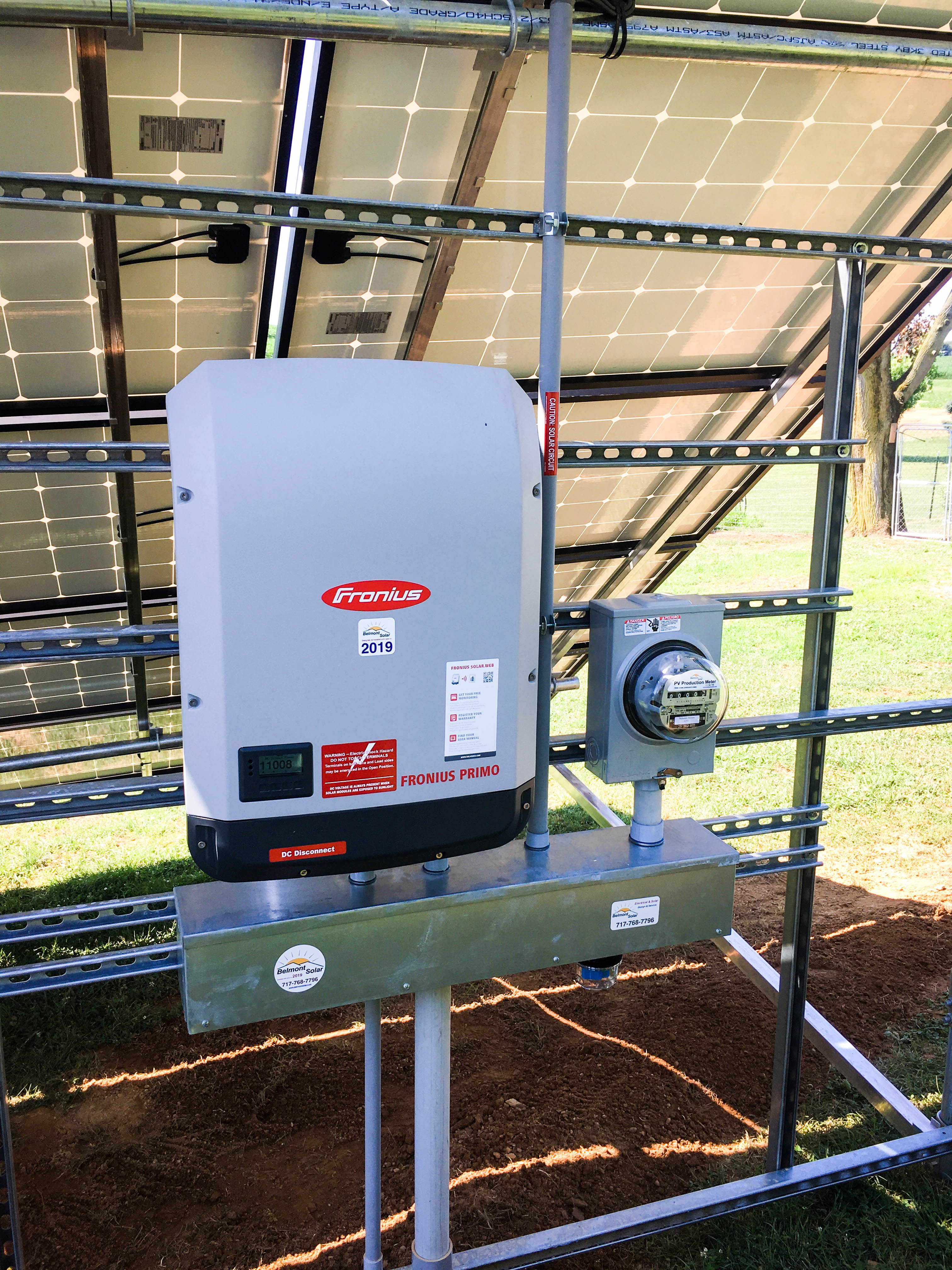 An inverter and net meter on a grid tied solar system array.